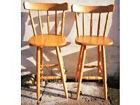 A pair of beech bar stools