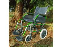 Breezy wide comfortable folding wheelchair with foot brakes