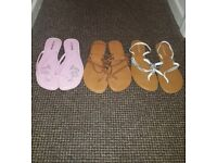 3 pairs of flip flops size 8