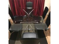Glass dining table and 6 leather chairs for sale in excellent condition delivery available
