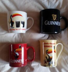 A Collection Of 4 Guinness Mugs.
