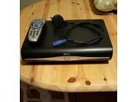 Sky + HD box with remote.