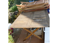 Wooden patio set with 6 chairs and a parasol