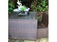 Rattan table and two chairs