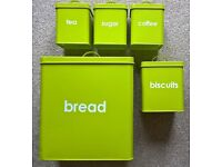 Lime green tea, coffee, sugar, biscuit and bread tins
