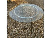 Chrome plated steel dining table with glass top