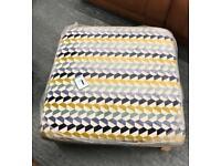 Coloured footstool / pouffe