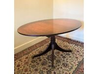 Reproduction Regency Style Oval 4 Leg Dining Table with Claw feet and extra leaf
