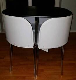 Brand new table and white chairs