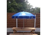 Fosters garden umbrella BNIB