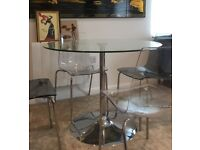 Round glass dining table - chairs NOT included