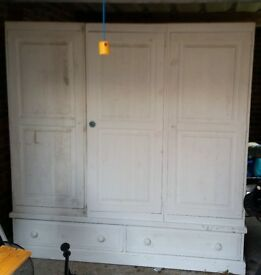 Triple Wooden Wardrobe with 2 Drawers - £50. Used and needing TLC. Must collect.