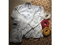 Martial arts karate gi, top, trousers and white, red and yellow belts