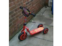 Three wheel scooter for young child. Disney Cars lighting McQueen design.