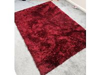 Large shaggy red rug