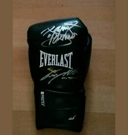 Duel signed boxing glove with Coa