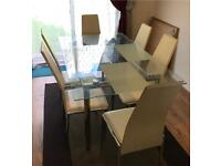 Toughened glass dining table and 6 leather chairs for sale in great condition delivery available
