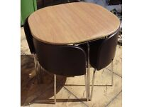 Dining table and 4 chairs. Wood-effect table and chocolate leather-effect chairs