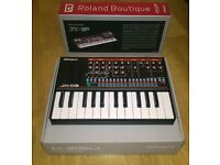 Roland JX-03 Synthesizer Module with keyboard.
