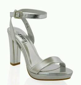 Silver High heel sandals size 6