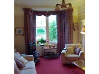 Large bay window curtains with matching valances, swags and tassels