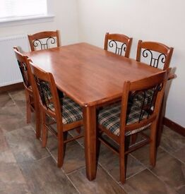 Dining table and six chairs in solid wood