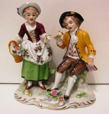 German Sitzendorf Figure Group of period girl and boy with flowers.