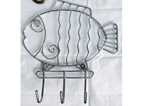 A chrome fish shape wall or door mounted slimline hanger, immaculate, quick sale at only £5
