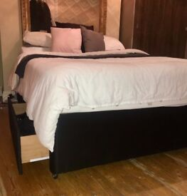 Black double bed base with draws