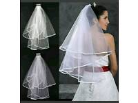 Brand new 2 tier elbow length veil in white. Only 2 left!