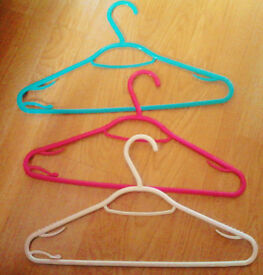 24 Plastic Coat Hangers in 3 Colours: 8 Blue, 8 Pink, 8 White.