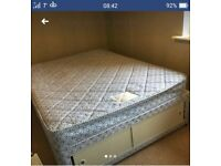 Double divan bed with mattress and storage
