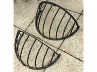 Pair of used large forged hay rack plant holders