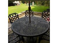 Garden table, 6 chairs & parasol