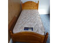 Single Slatted Wooden Bed and Mattress.