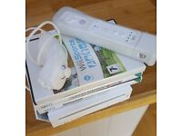 wii console, games nunchuck and controller