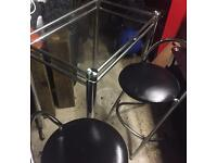 GLASS TABLE WITH 2 STOOLS REDUCED