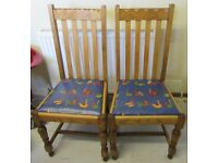 Pair of Oak chairs with wipe-able bird print pattern on seat
