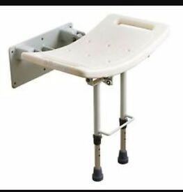 Disability fold down shower seat