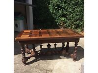 Dining table with ornate base