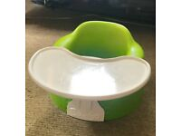 Bumbo floor seat in green with PlayTray