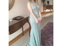 Prom/ bridesmaid's dress by Angel Forever with beautiful detail on the front and open back, size 10