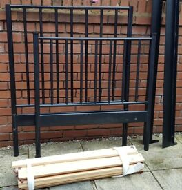 single-size IKEA bed frame, (heavy) iron metal. black. In good condition.