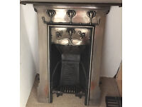 ART NOUVEAU CAST IRON FIREPLACE WITH GRATE AND FIRE BARS.
