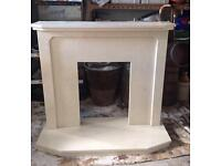Solid cream marble fireplace and hearth