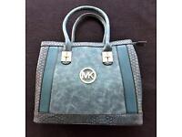 Woman's designer Michael Kors bag.