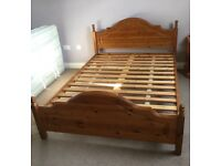 Solid pine bedroom furniture including bed, bedside cabinets, chest of drawers and wardrobe