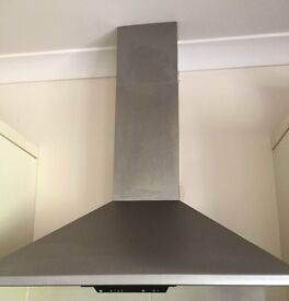 Whirlpool vented electric cooker hood.