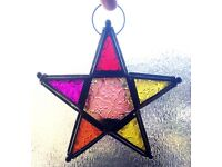 Hanging stained glass star with built in tealight holder