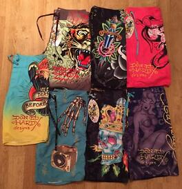 7 pairs of brand new authentic Ed Hardy and Christian Audigier men's swim shorts. RRP £120 each